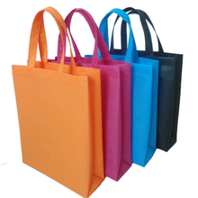 Portable colorful nonwoven bag pp spun bond non woven fabric supplier